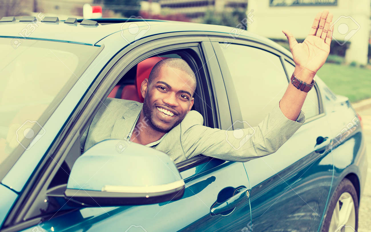 Portrait Happy Young Man Driver Stuck His Hand Out Of The Car Window  Excited About His
