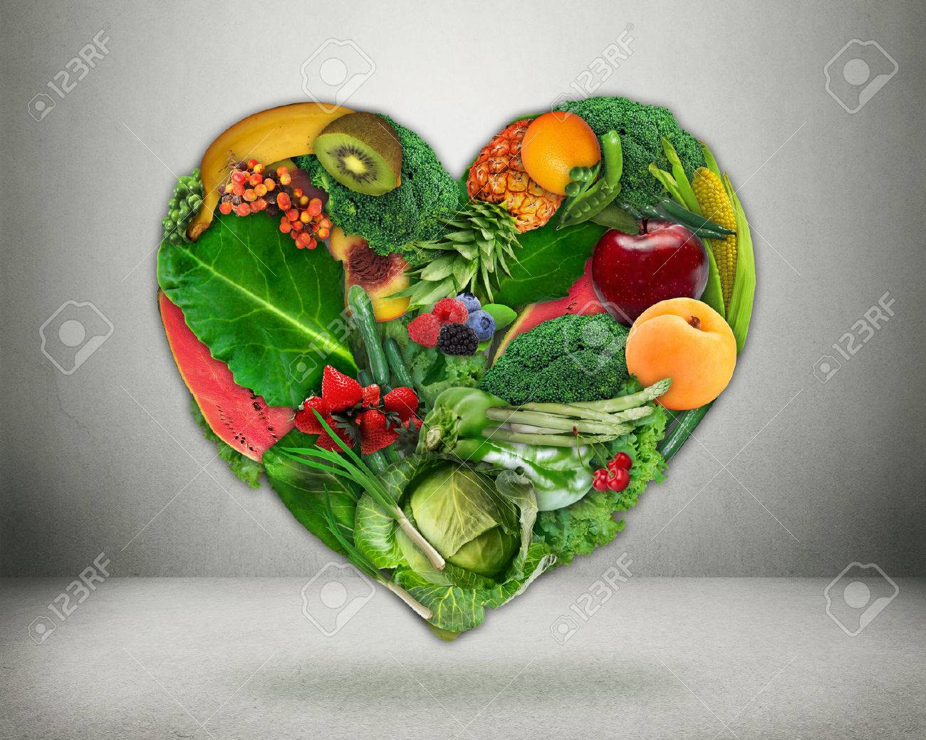 Healthy diet choice and heart health concept. Green vegetables and fruits shaped as heart Heart disease prevention and food. Medical health care and nutrition dieting - 44098898