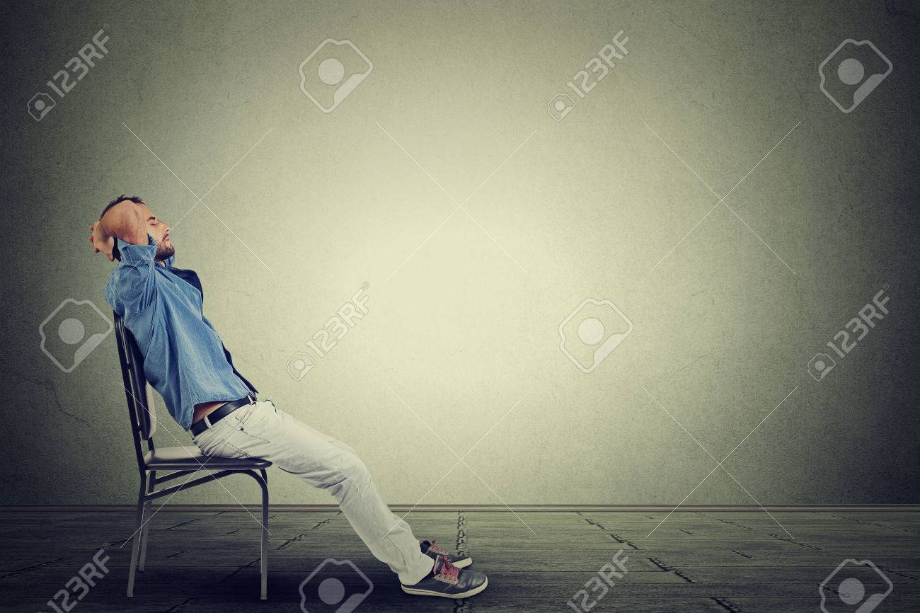 Side profile young business man relaxes in his empty office - 46737923