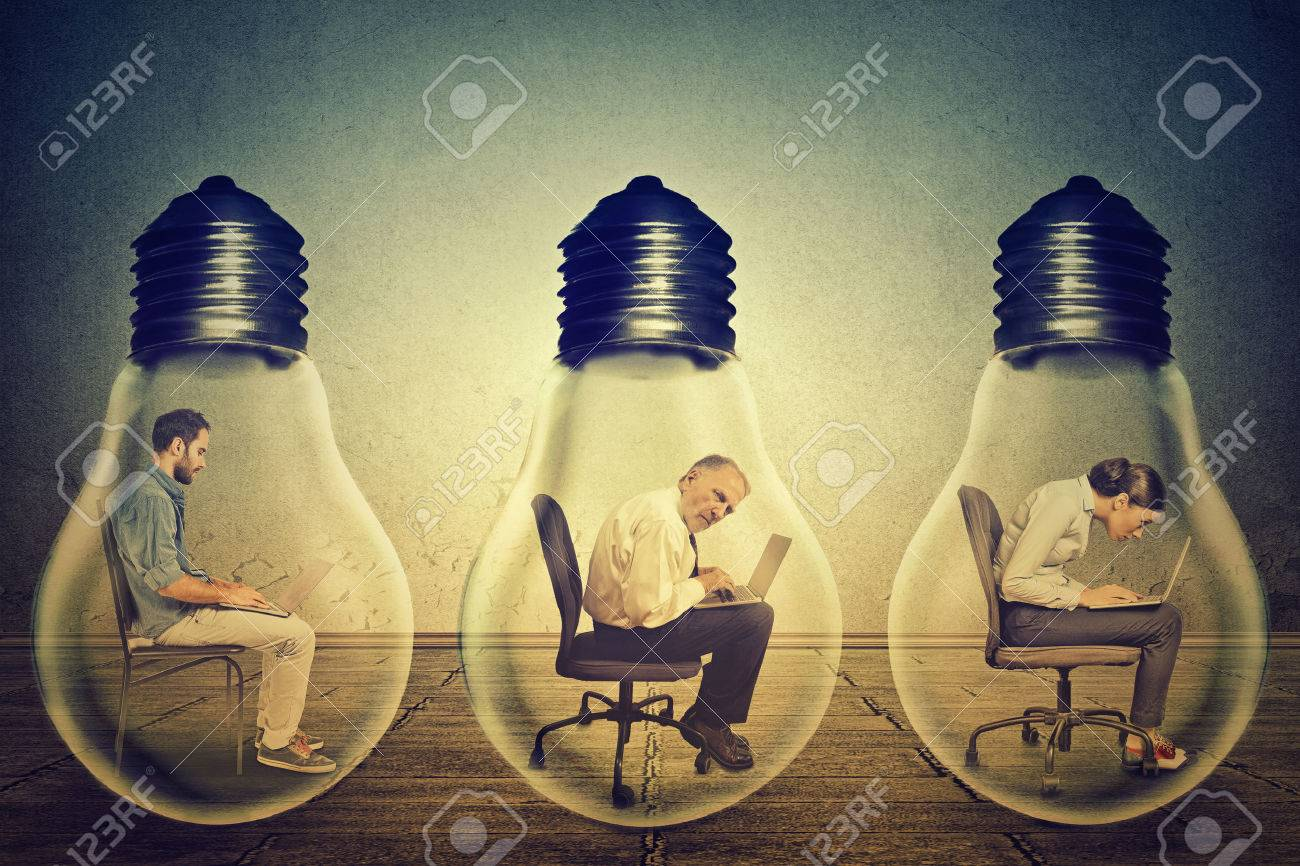 Side profile company employees sitting in row inside electric lamp using working on computer in corporate office isolated gray wall background. Generate idea concept. Working conditions productivity - 46737933