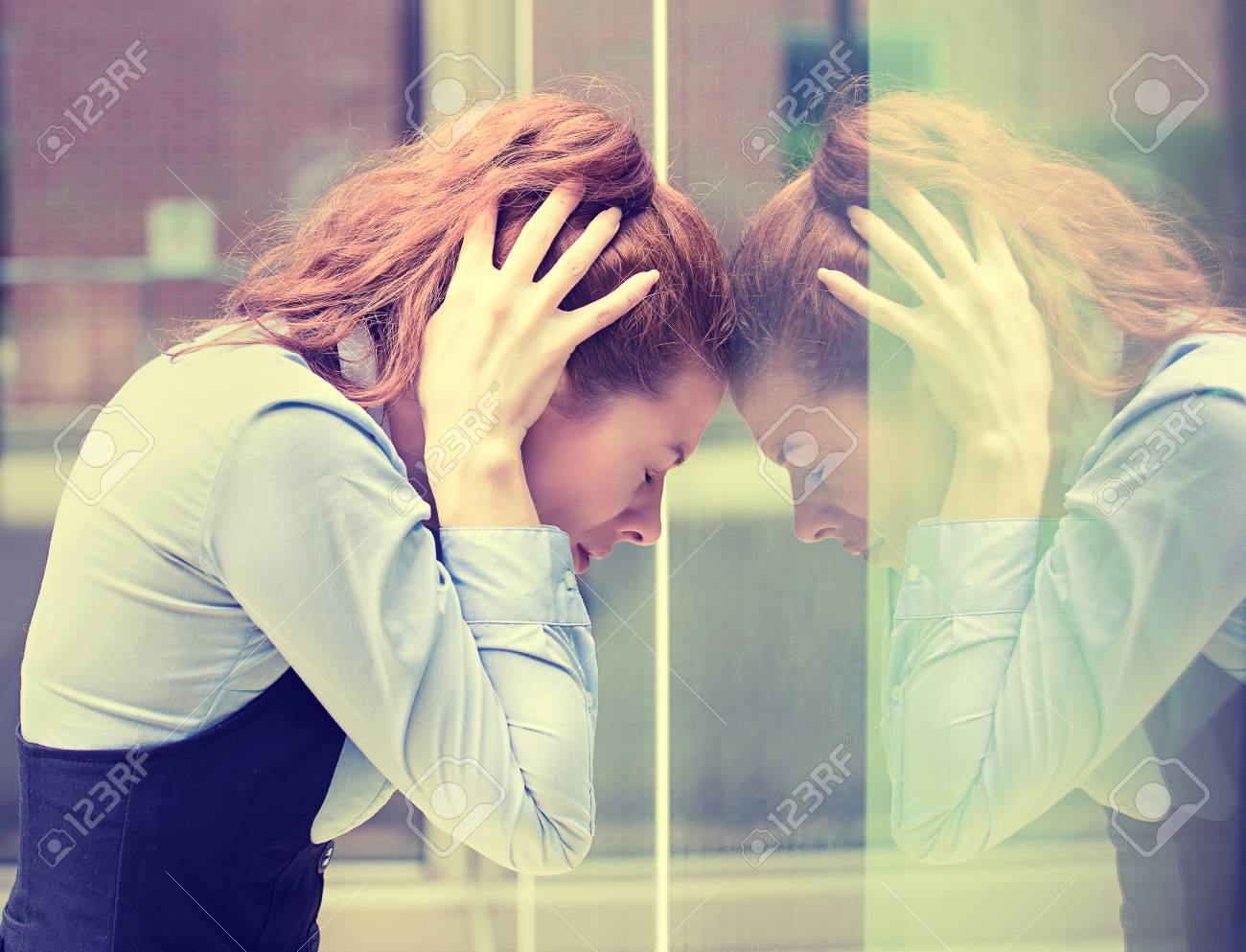 portrait stressed sad young woman outdoors. City urban life style stress - 50100584