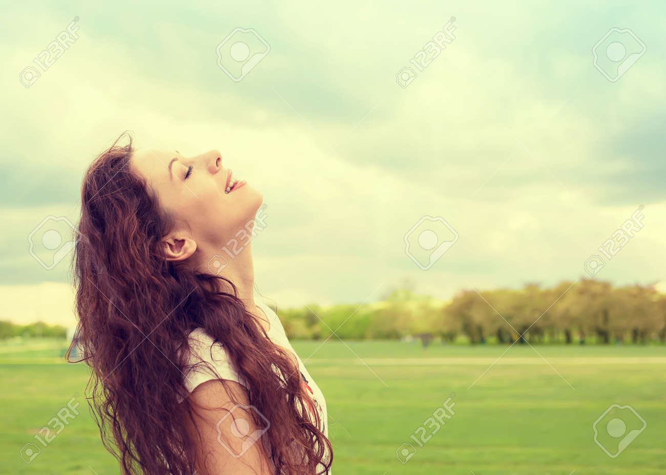 Side Profile Woman Smiling Looking Up To Blue Sky Celebrating Stock Photo Picture And Royalty Free Image Image 50100763
