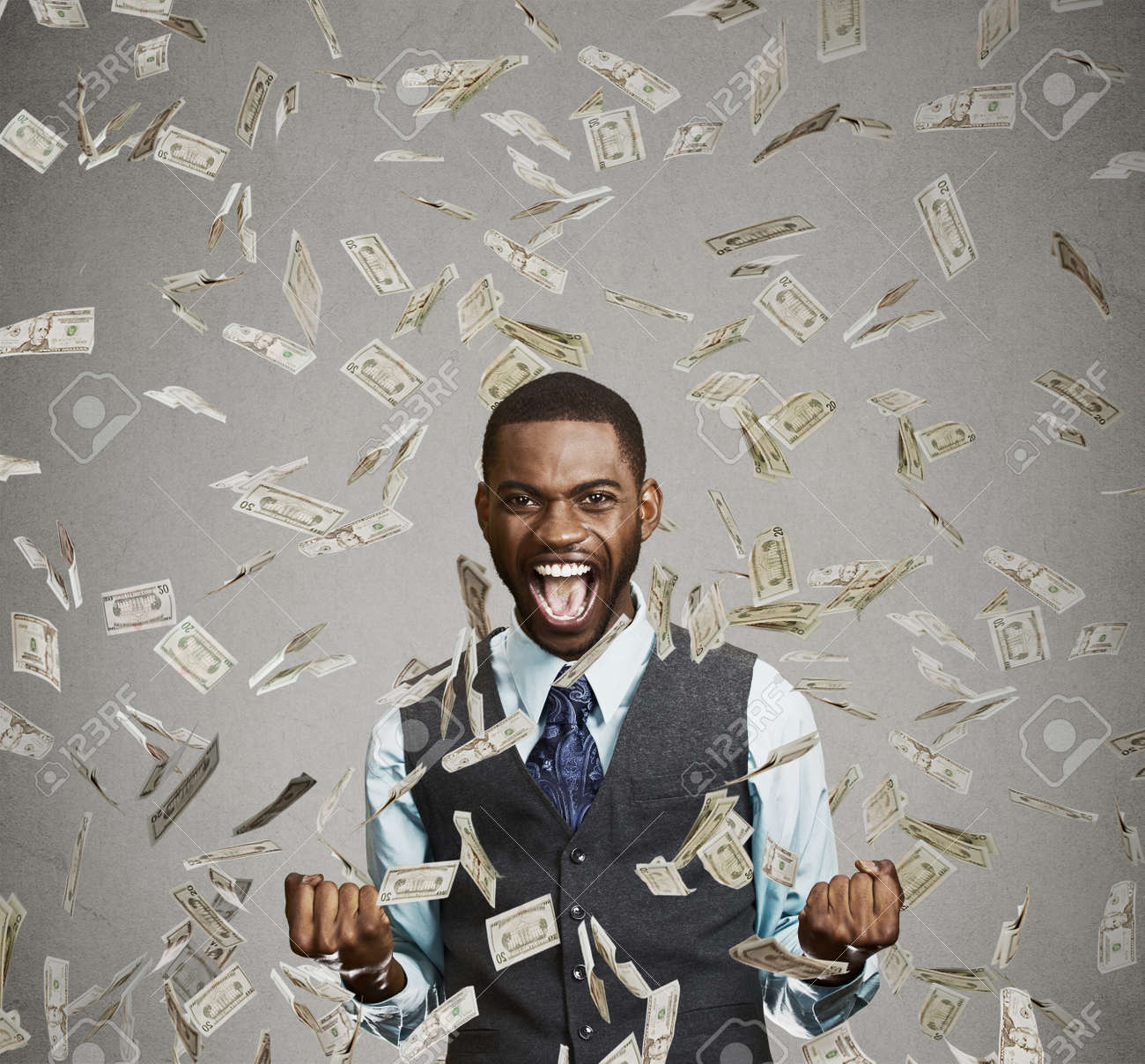 Portrait happy man exults pumping fists ecstatic celebrates success screaming under money rain falling down dollar bills banknotes isolated gray background with copy space. Financial freedom concept - 50995263