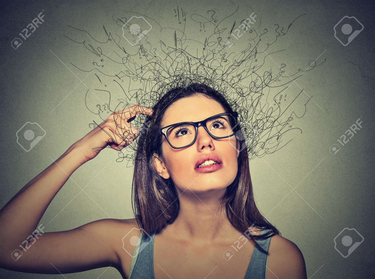 Closeup Portrait Young Woman Scratching Head Thinking Daydreaming With Brain Melting Into Lines Question Marks