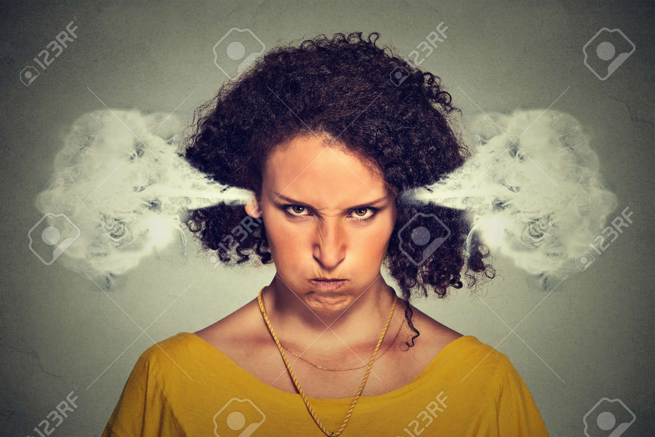 Closeup portrait of angry young woman, blowing steam coming out of ears, about to have nervous atomic breakdown, isolated gray background. Negative human emotions facial expression feelings attitude - 51742530