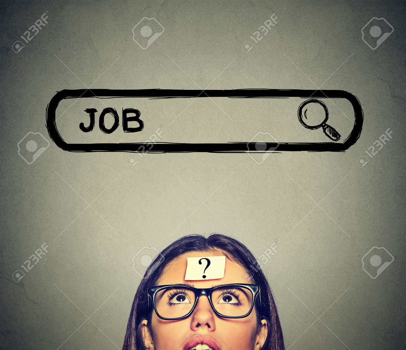 job images stock pictures royalty job photos and stock job headshot young w in glasses thinking looking for a new job isolated on gray