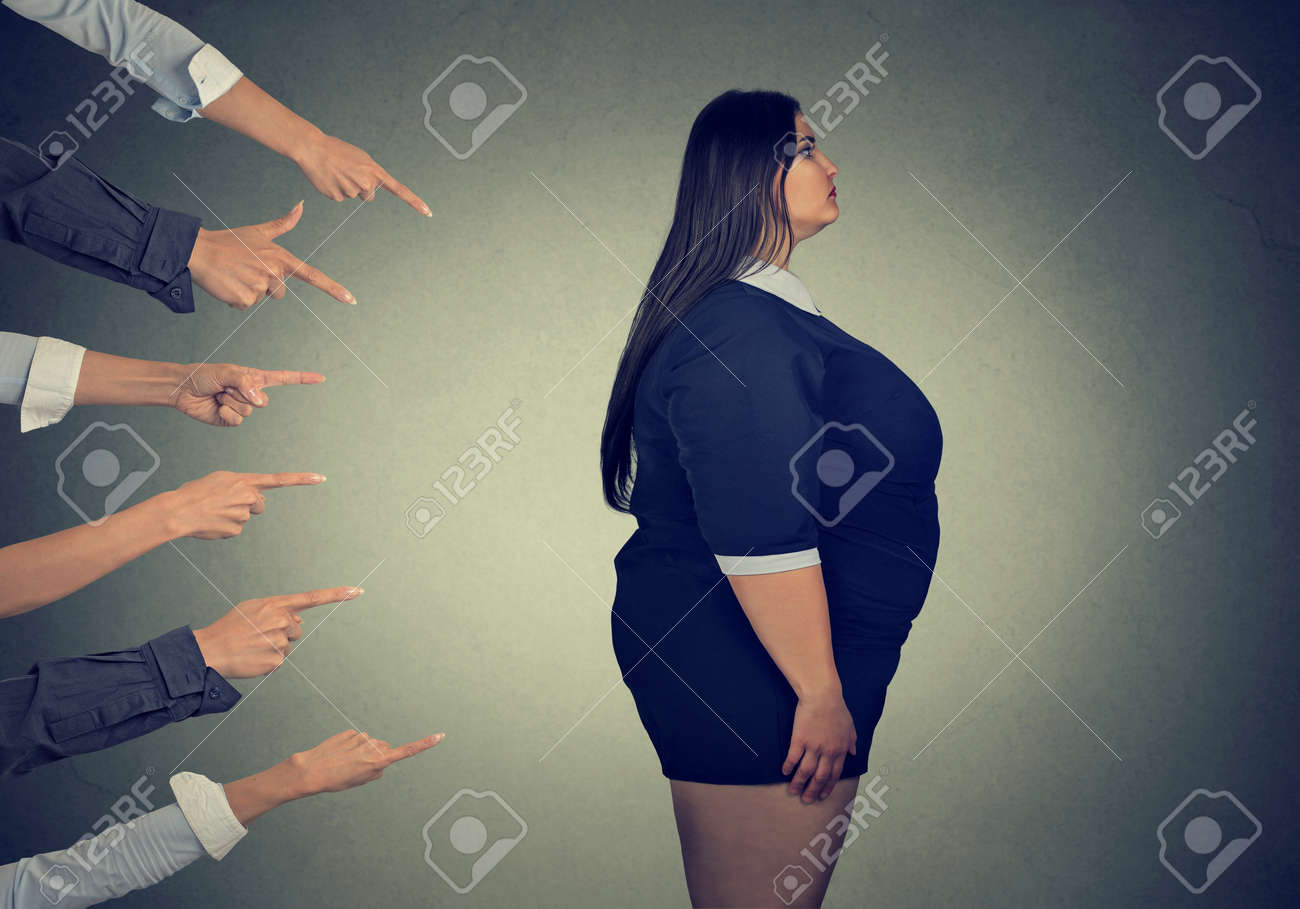 Many fingers pointing at fat woman - 78454764