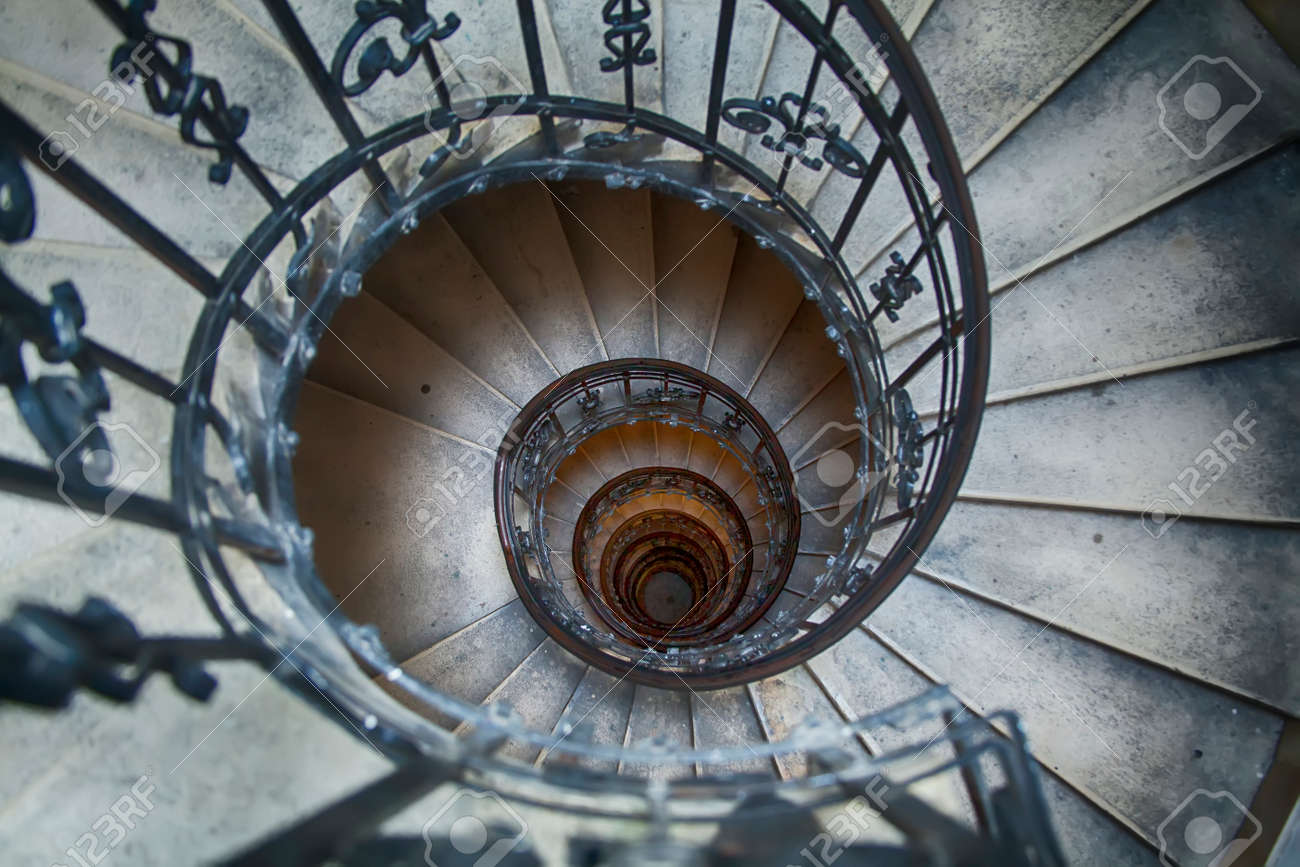Stock Photo   Straight Down View Of A Winding Staircase