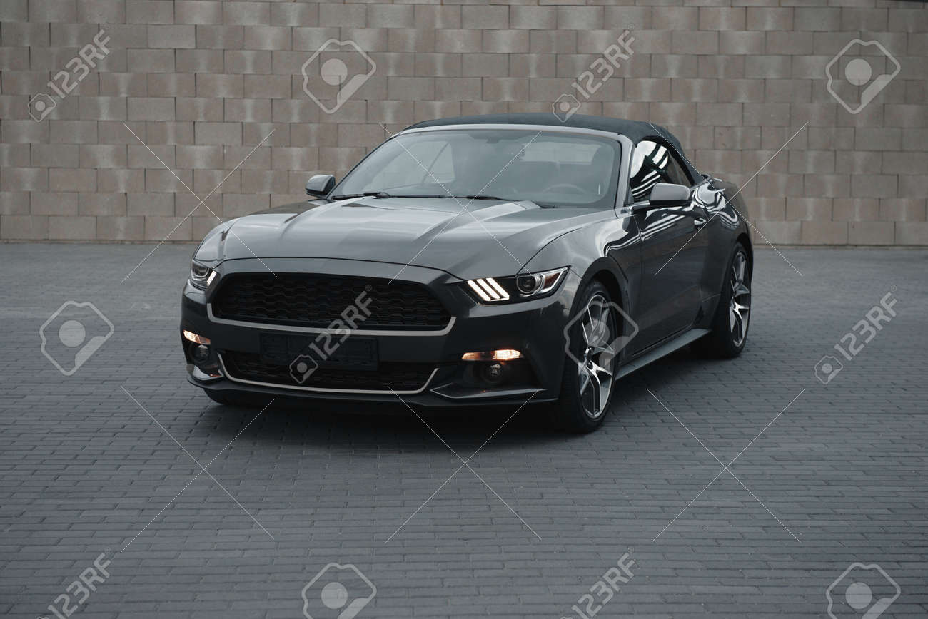 Kaunas, Lithuania - MAY 4, 2019: Gray american muscle car Ford Mustang GT with modifications standing alnone at city malls parking. - 140575577