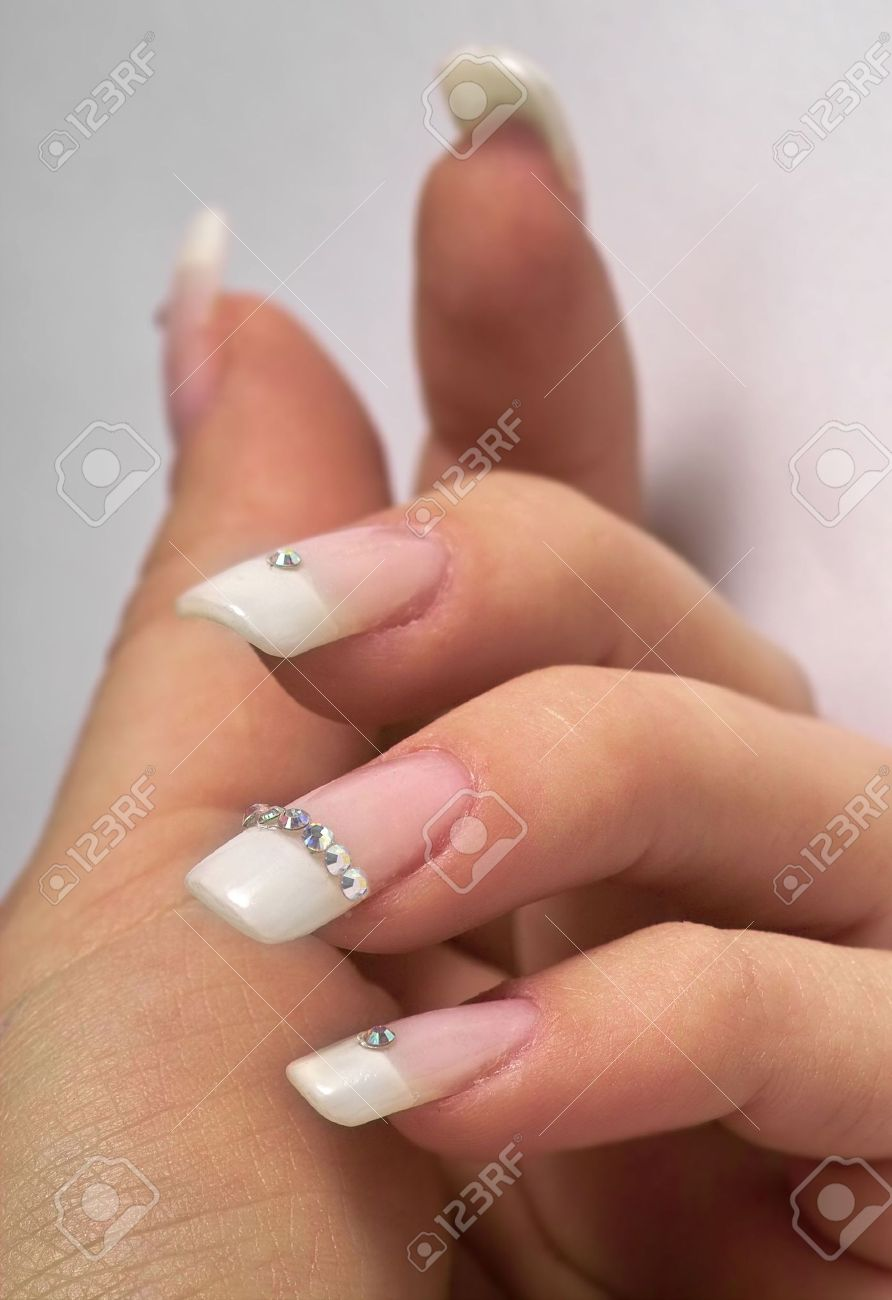 Beautiful Hands With French Manicure And Diamonds Stock Photo