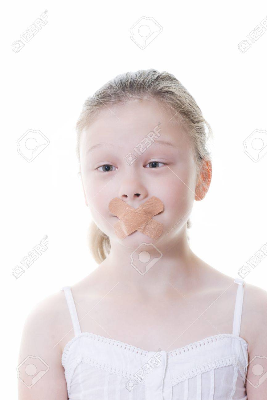 preteen girl with sticking plaster across her mouth Stock Photo - 14231870