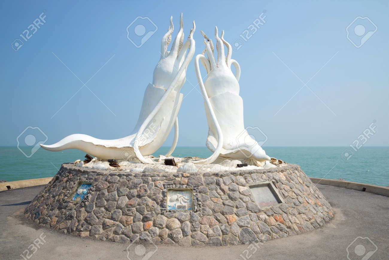 Sculpture Of Two Giant Squid In The Background Of The Gulf Of