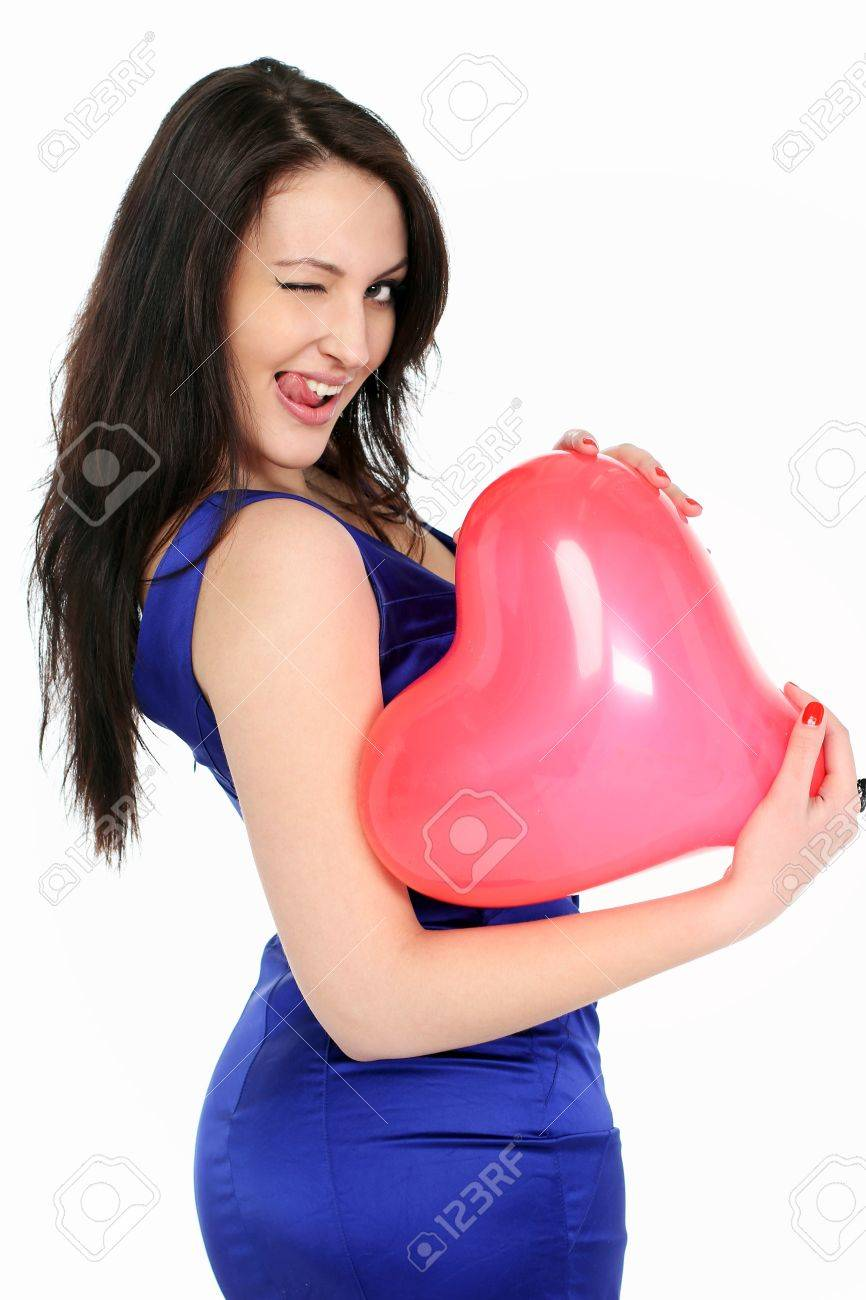 portrait of a beautiful girl with a red balloon in her hands Stock Photo - 12746384