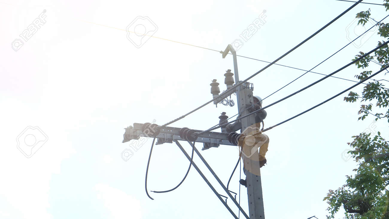 Asian Thai worker alone, he chang the cable line on the pole