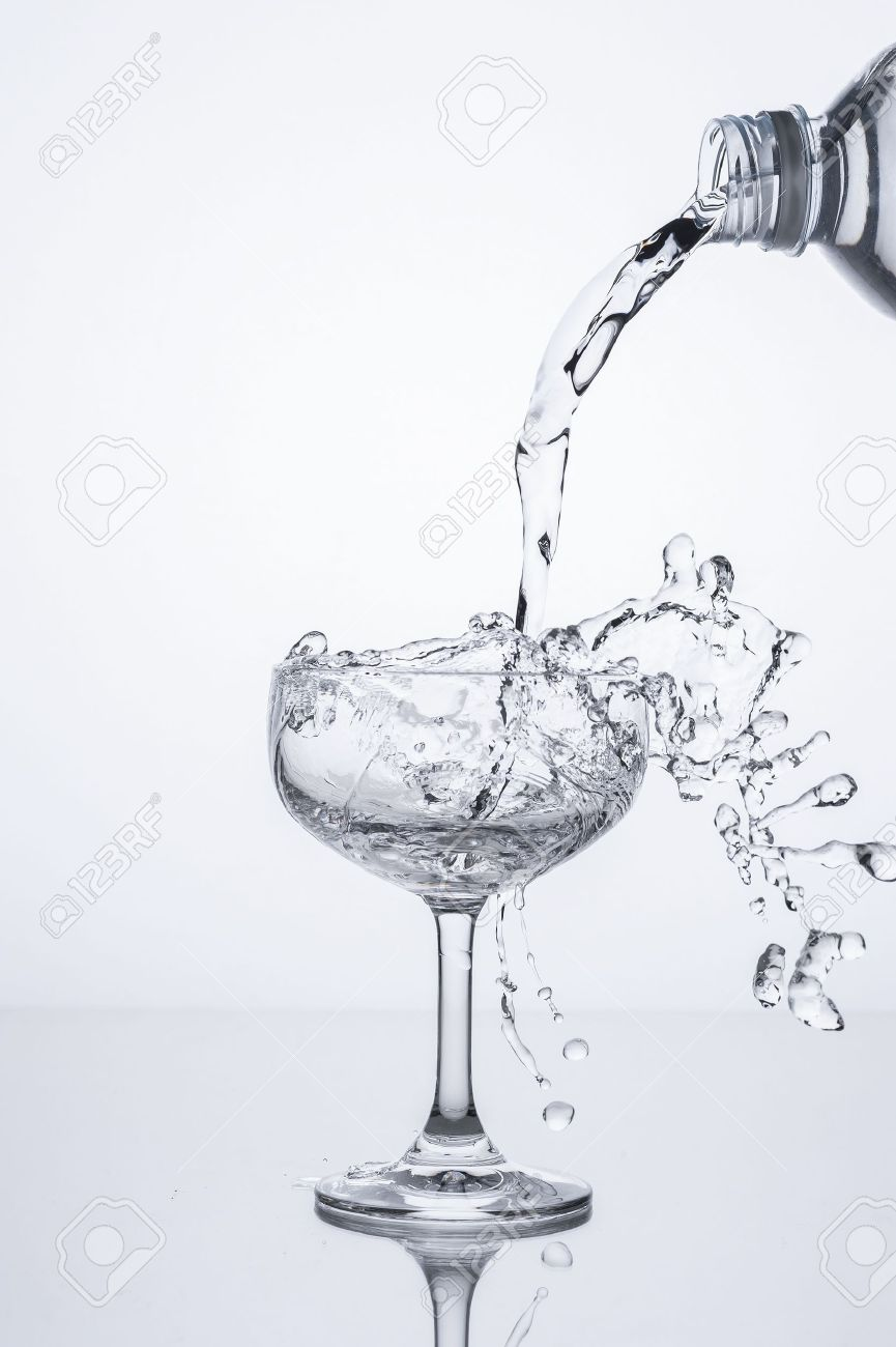 pouring water into glass stock photo picture and royalty free image