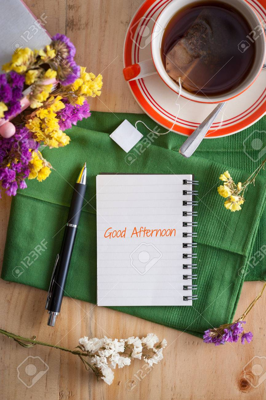Good Afternoon Is Written On Opened Notepad With Pen And A Stock