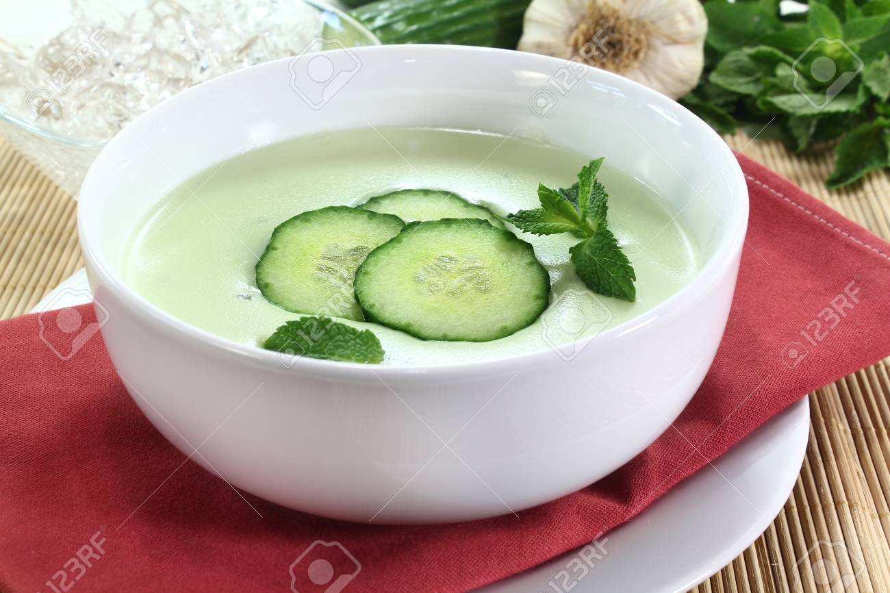 cold cucumber soup with slices of cucumber and mint Stock Photo - 12123904