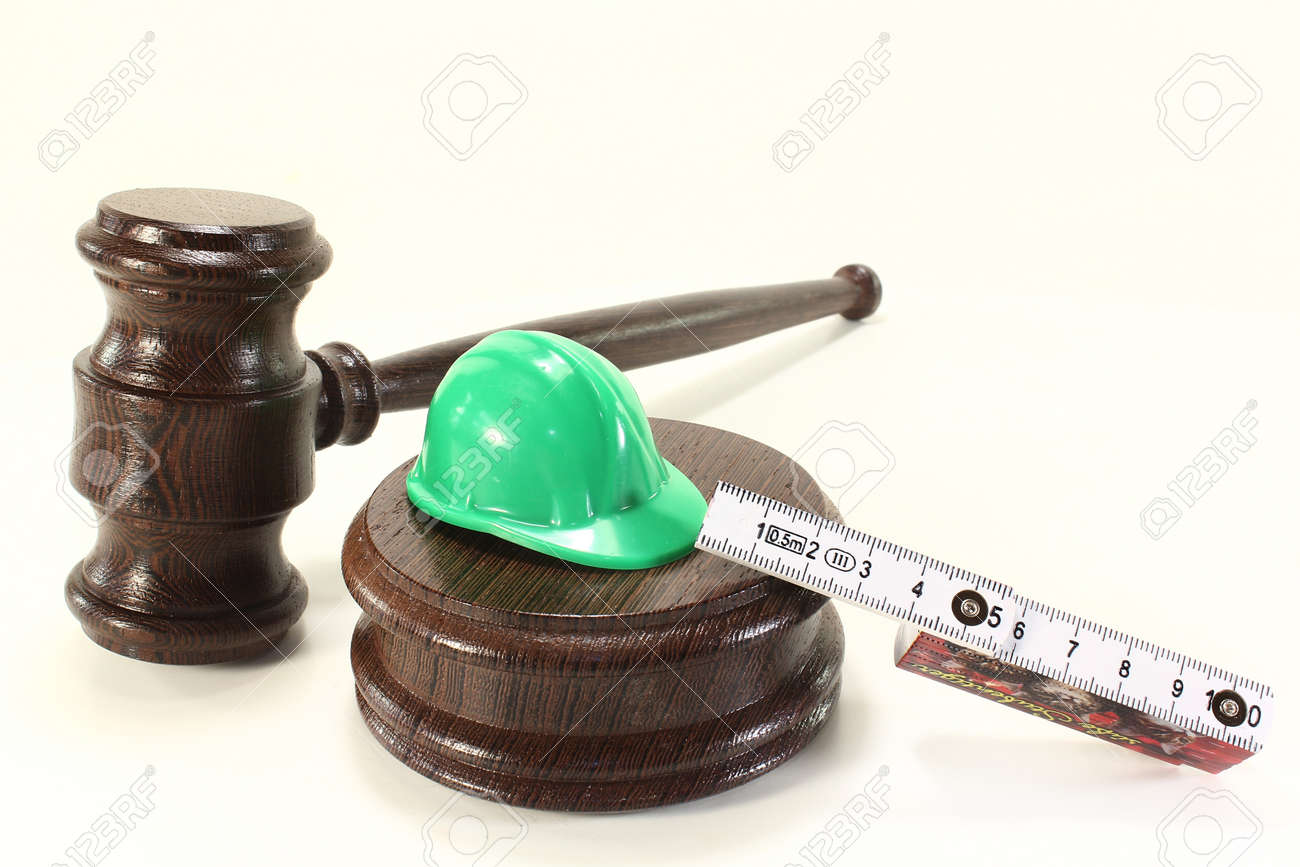 judges gavel with building-site helmet and double meter stick on a light background Stock Photo - 13552263