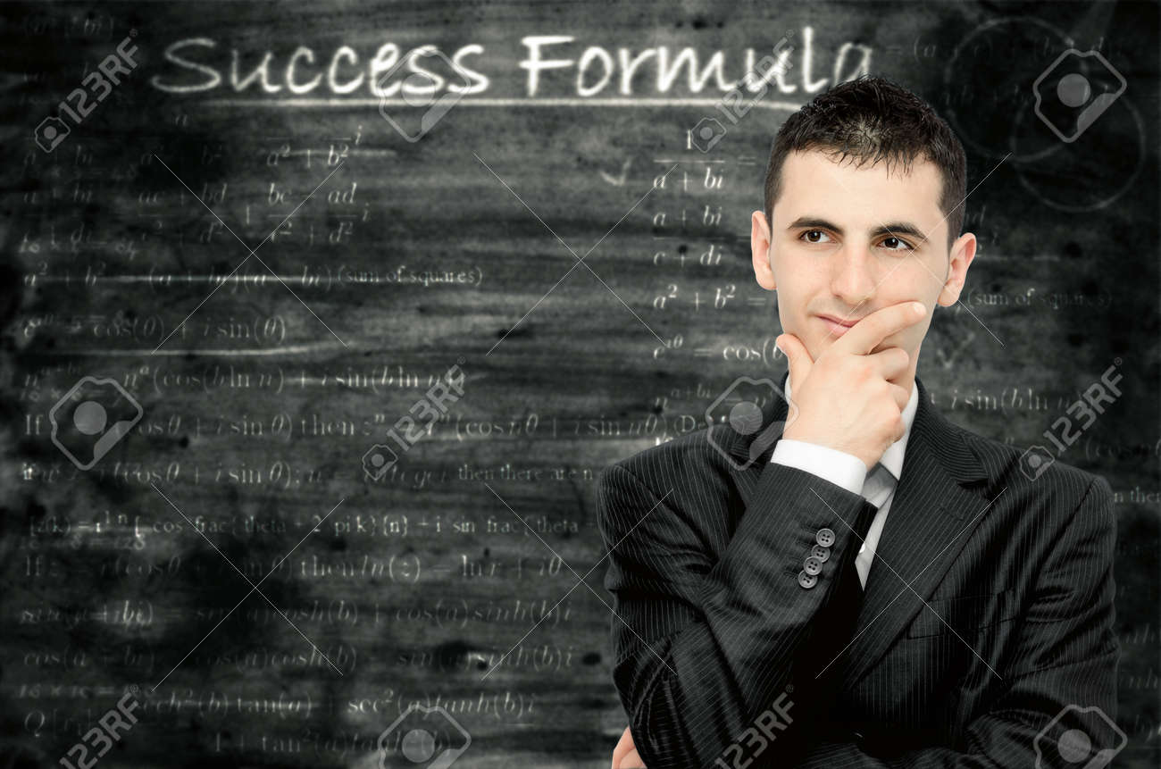 A young businessman who is thinking about a formula for success Stock Photo - 9832792