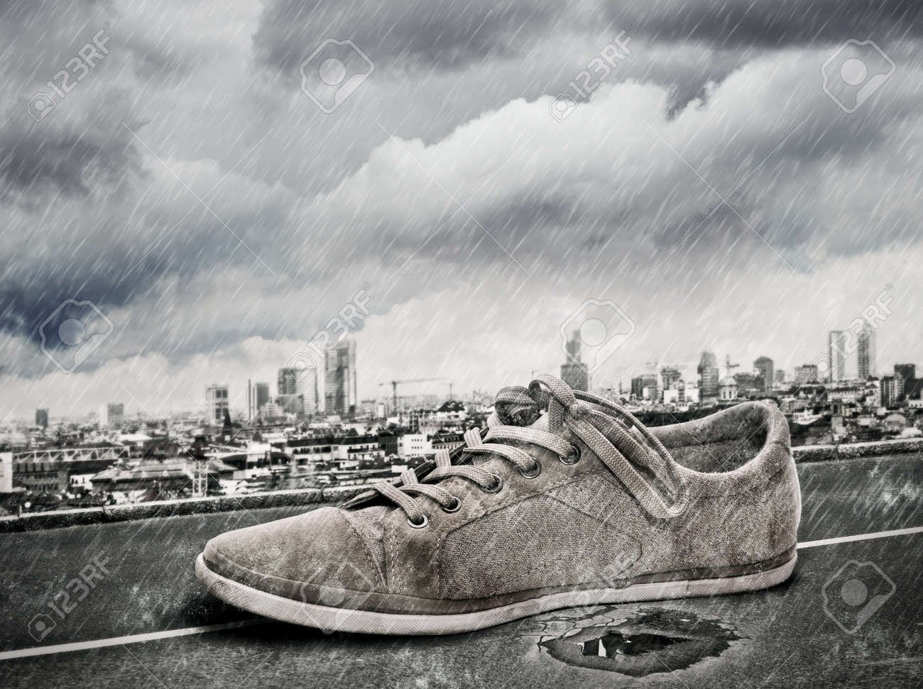 Single shoes walking on the street while is raining Stock Photo - 11293174