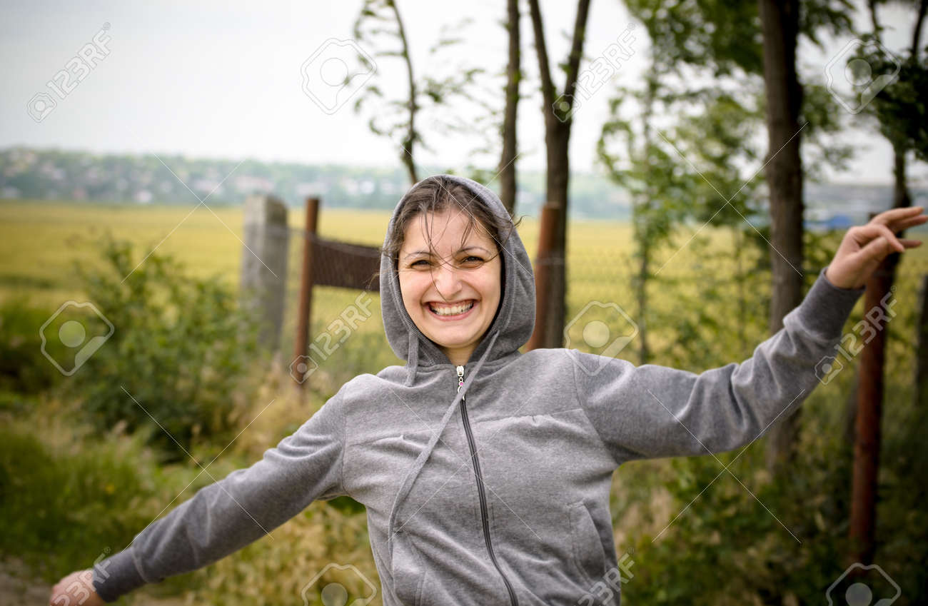 Girl with happy face running in nature Stock Photo - 13357106