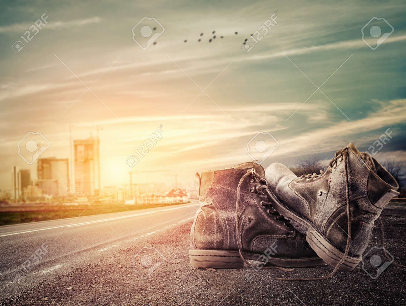 Pair of boots sit on the edge of the road Stock Photo - 17607080