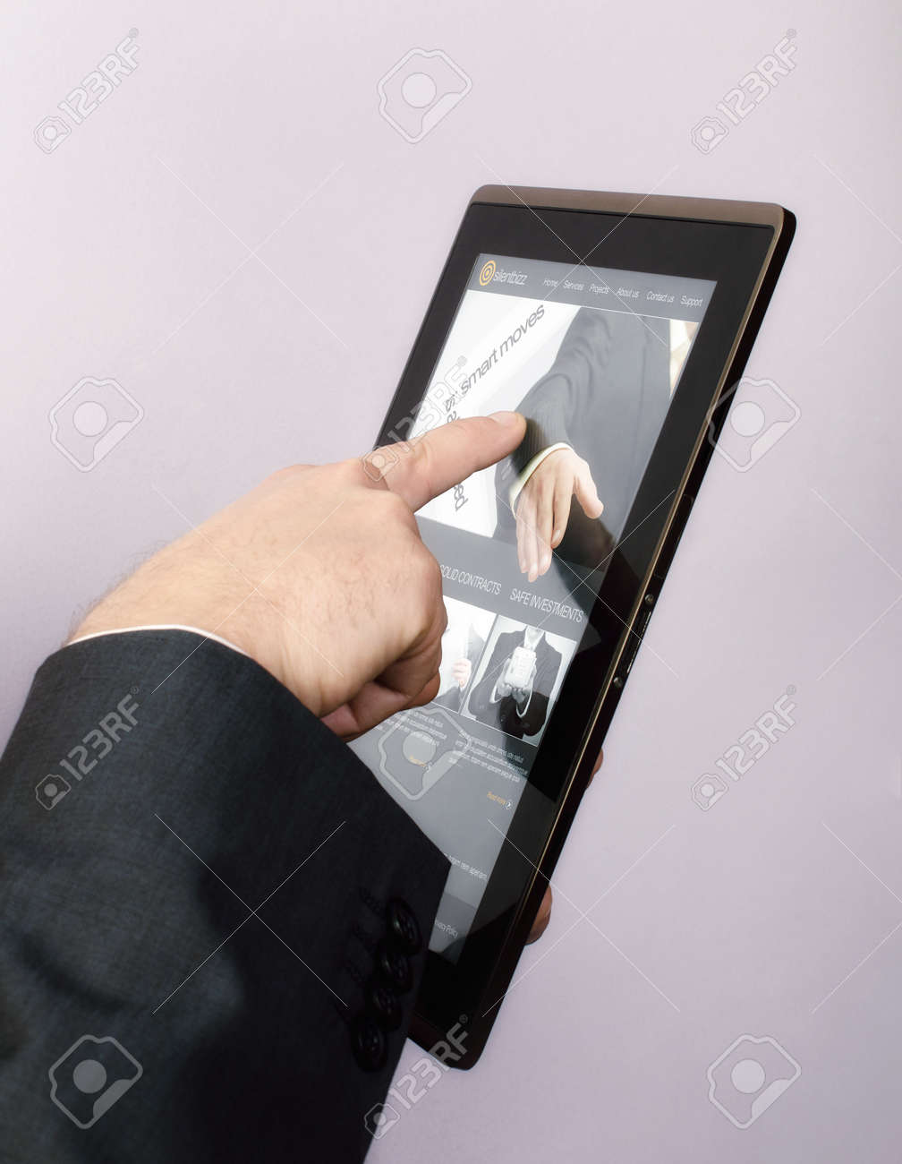 Finger touching screen on tablet-pc and browsing a website.The Website from the image was created by me and the pictures used can be found in my portfolio Stock Photo - 17597536