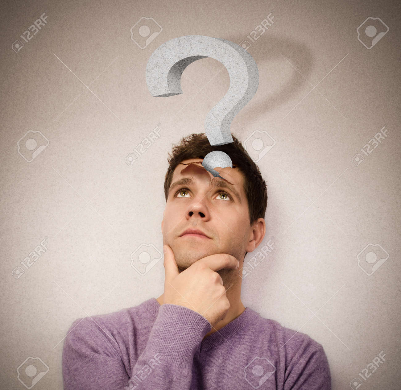 Young man lost in thought with a question mark leaving the head Stock Photo - 18085674