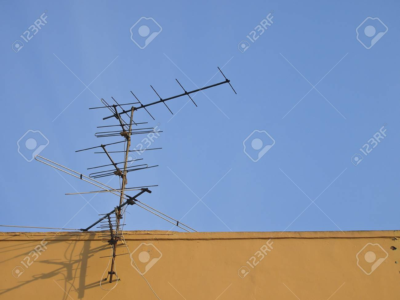 receive antenna on top roof in blue sky