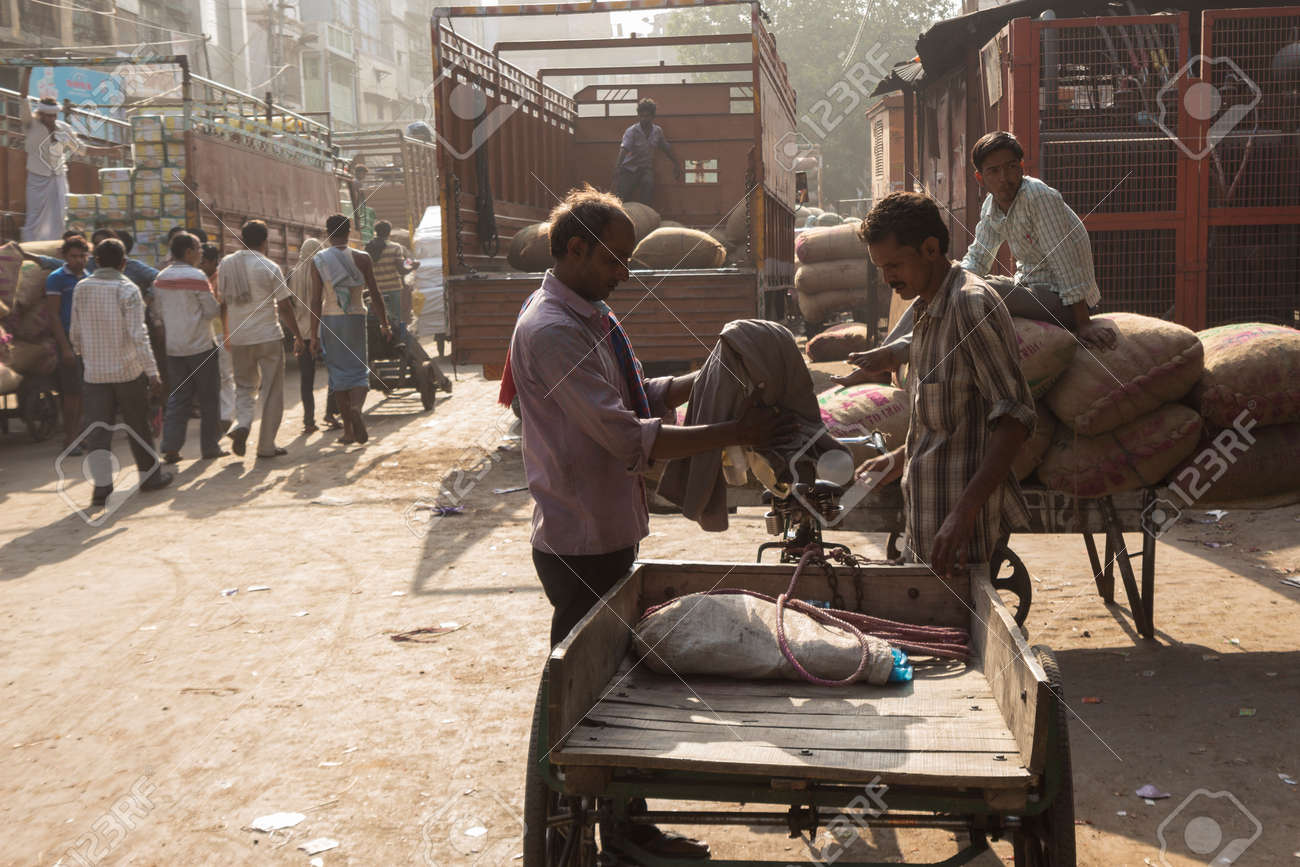 DELHI INDIA - JUN 6 : unidentified india worker at spice market