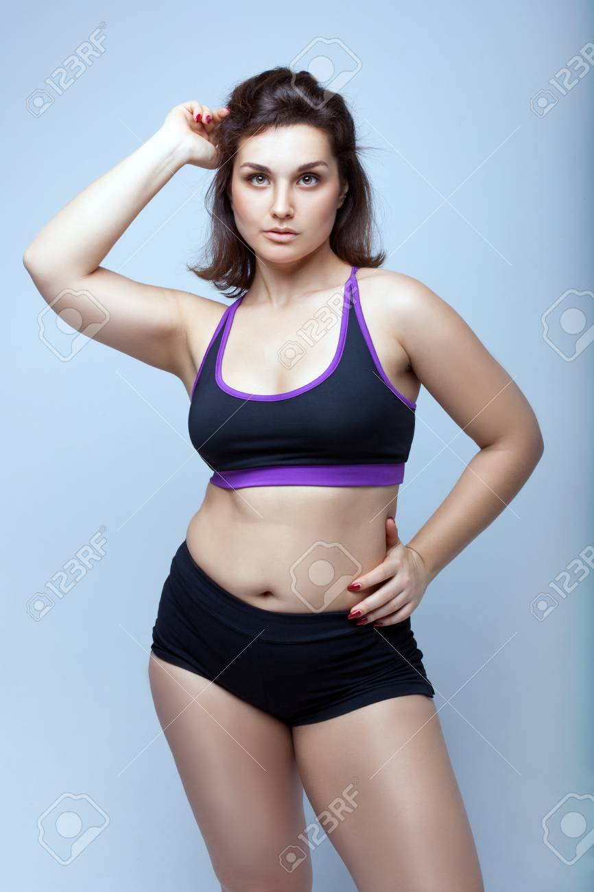 Portrait of a beautiful plump girl in sportswear. Stock Photo - 95544051 6e77675c1