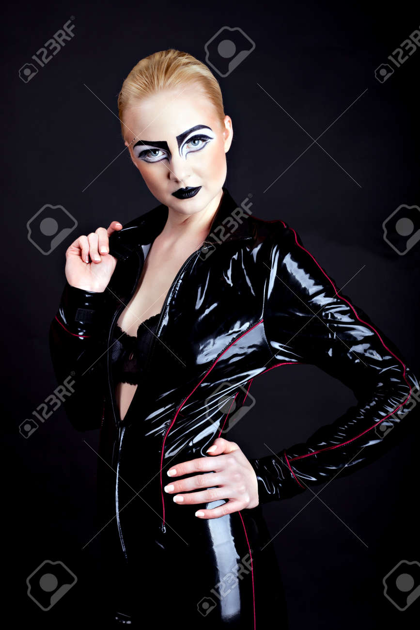 woman in latex, attractive domina on black Stock Photo - 12640786