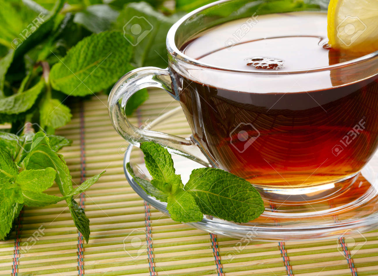 Cup of tea with lemon and mint Stock Photo - 15077632