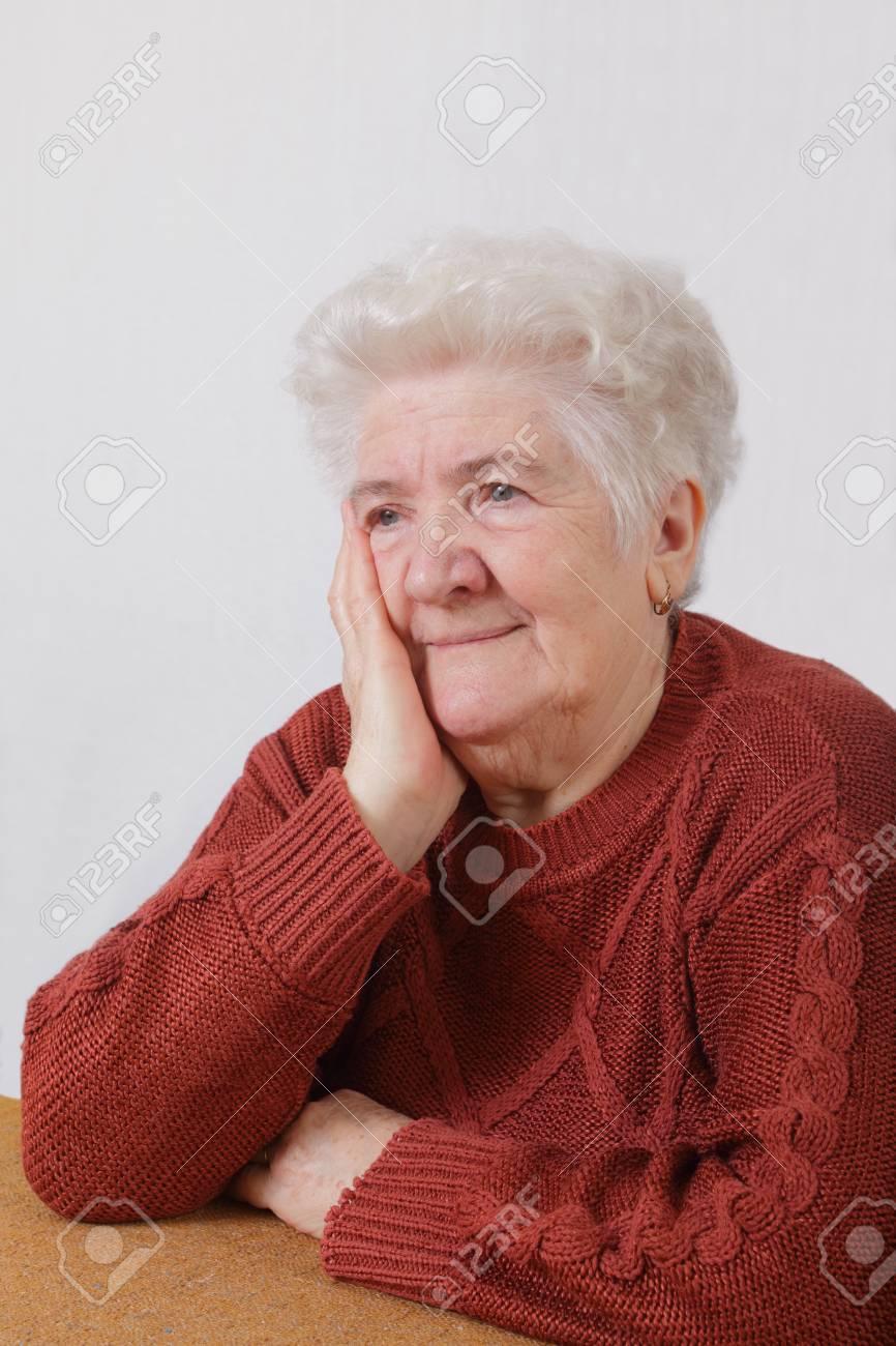 Portrait of worried senior woman in her room Stock Photo - 8808151