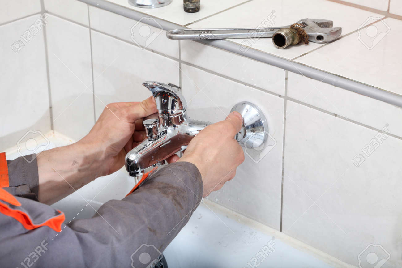 Plumber Hands Fixing Water Tap With Spanner Stock Photo, Picture And ...