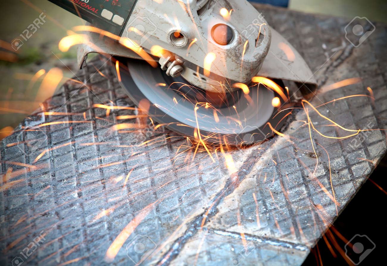 Grinding, close up of  tool and sparks Stock Photo - 9678154