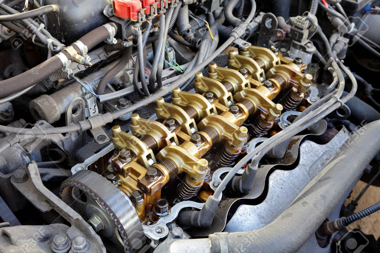 Close up of gasoline car engine,  three valve per cylinder  system Stock Photo - 10803094