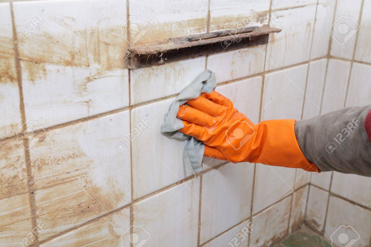 Cleaning Of Dirty Old Tiles In A Bathroom Stock Photo, Picture And ...