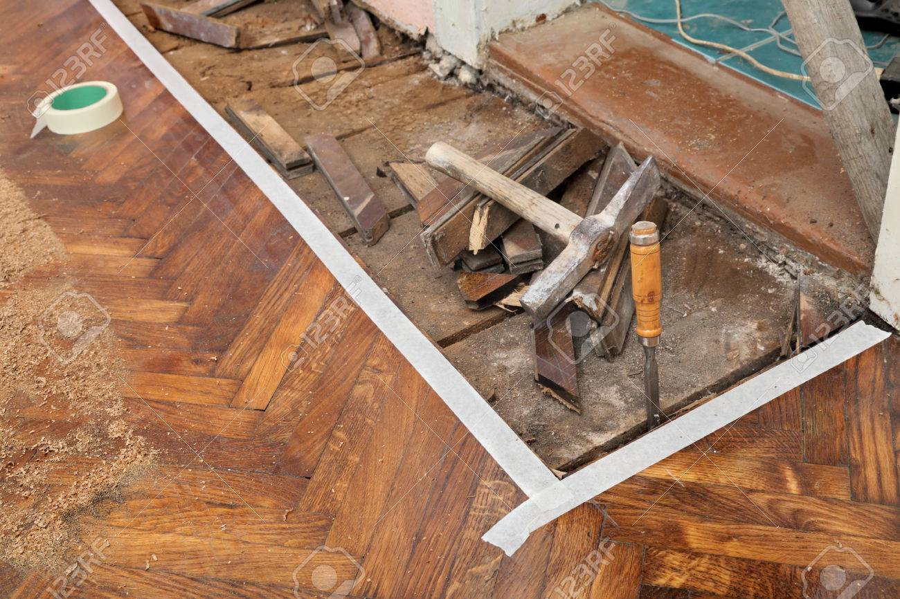 Old Parquet Floor Remove With Chisel Hammer Tools Stock Photo