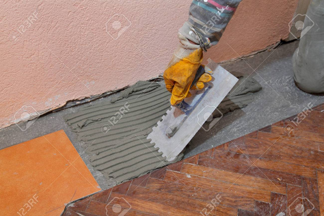 Home renovation worker trowel spreading mortar for ceramic tile home renovation worker trowel spreading mortar for ceramic tile stock photo 23174686 dailygadgetfo Image collections
