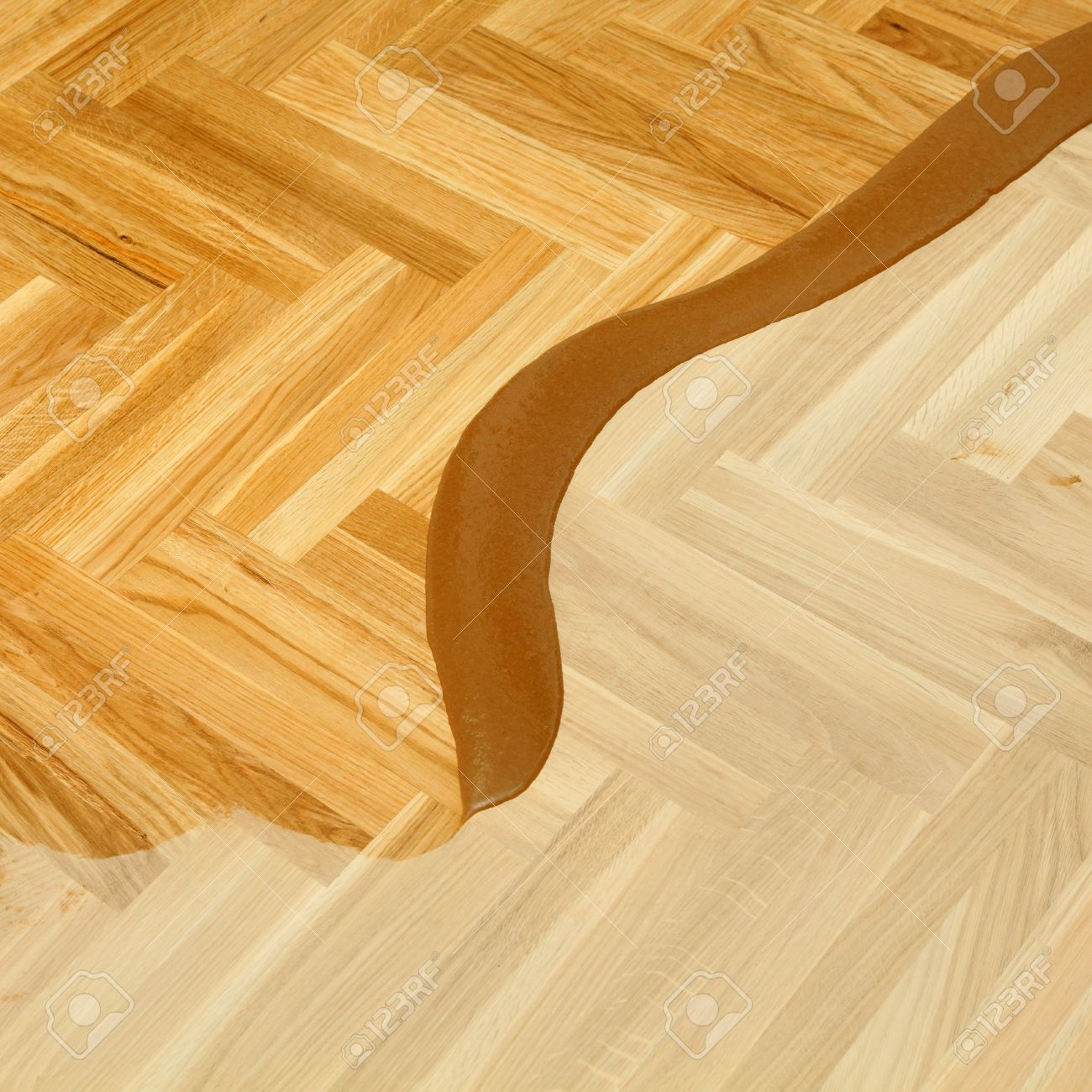 Varnishing Of Oak Parquet Floor First Layer Of Lacquer Stock