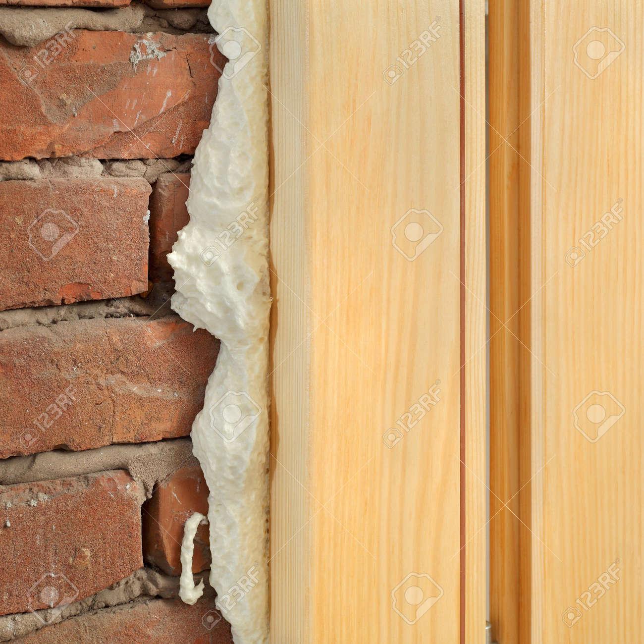 Stock Photo - Wooden door or window install closeup of polyurethane foam wood and bricks & Wooden Door Or Window Install Closeup Of Polyurethane Foam Wood ...