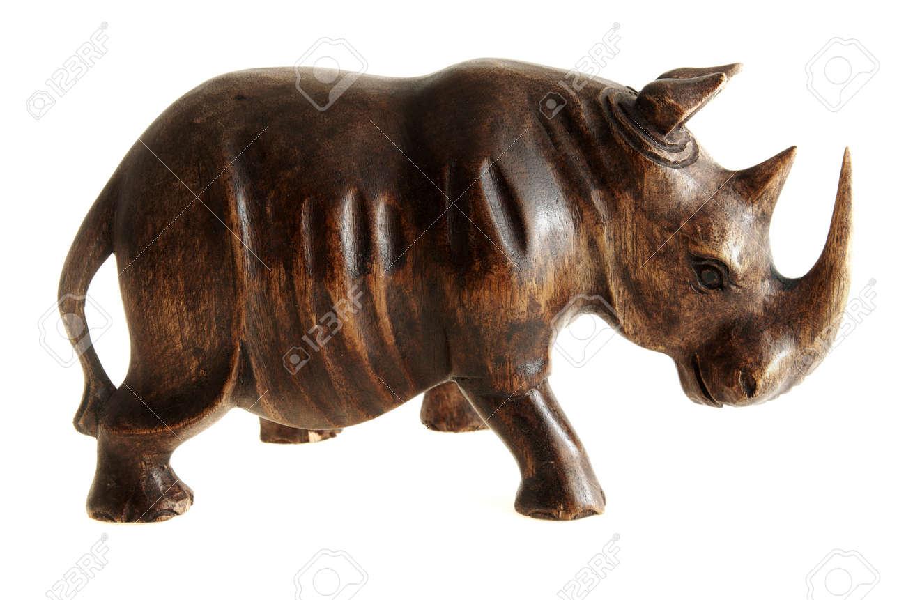 Figurine of rhinoceros made of wood. Stock Photo - 17125051