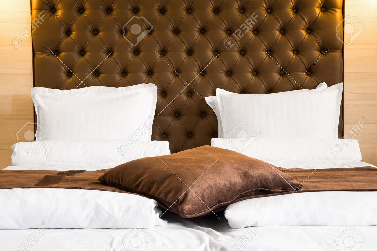 Luxury Queen Size Bed With A Brown Upholstered Headboard And Stock Photo Picture And Royalty Free Image Image 60928598