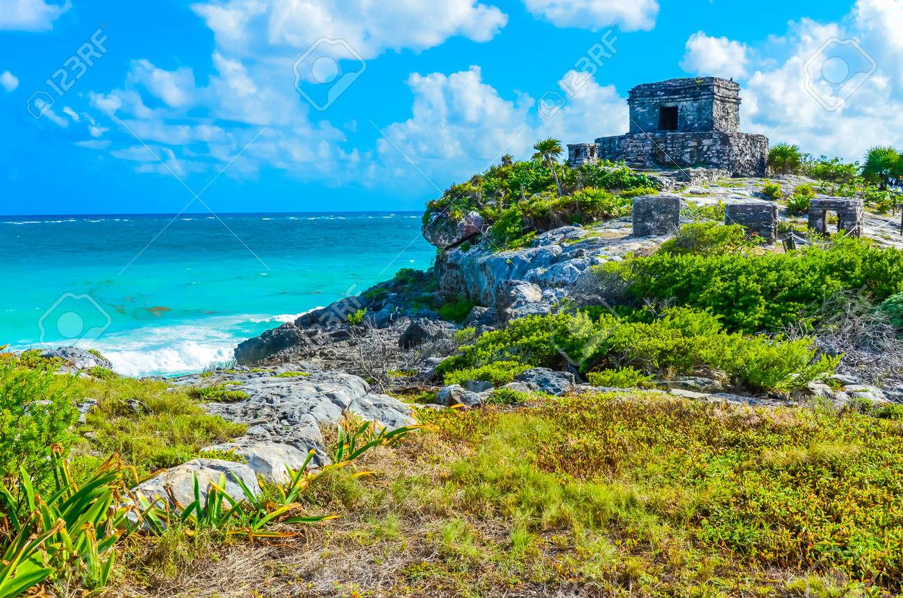Mayan ruins of Tulum at tropical coast. God of Winds Temple at paradise beach. Mayan ruins of Tulum, Quintana Roo, Mexico. - 82873158