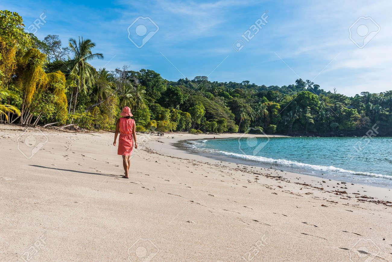 Manuel Antonio, Costa Rica - Girl walking at beautiful tropical beach - 83983572