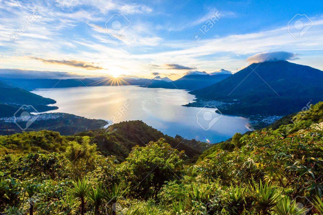 Sunrise in the morning at lake Atitlan, Guatemala - amazing panorama view to the volcanos San Pedro, Toliman and Atitlan - 89678885