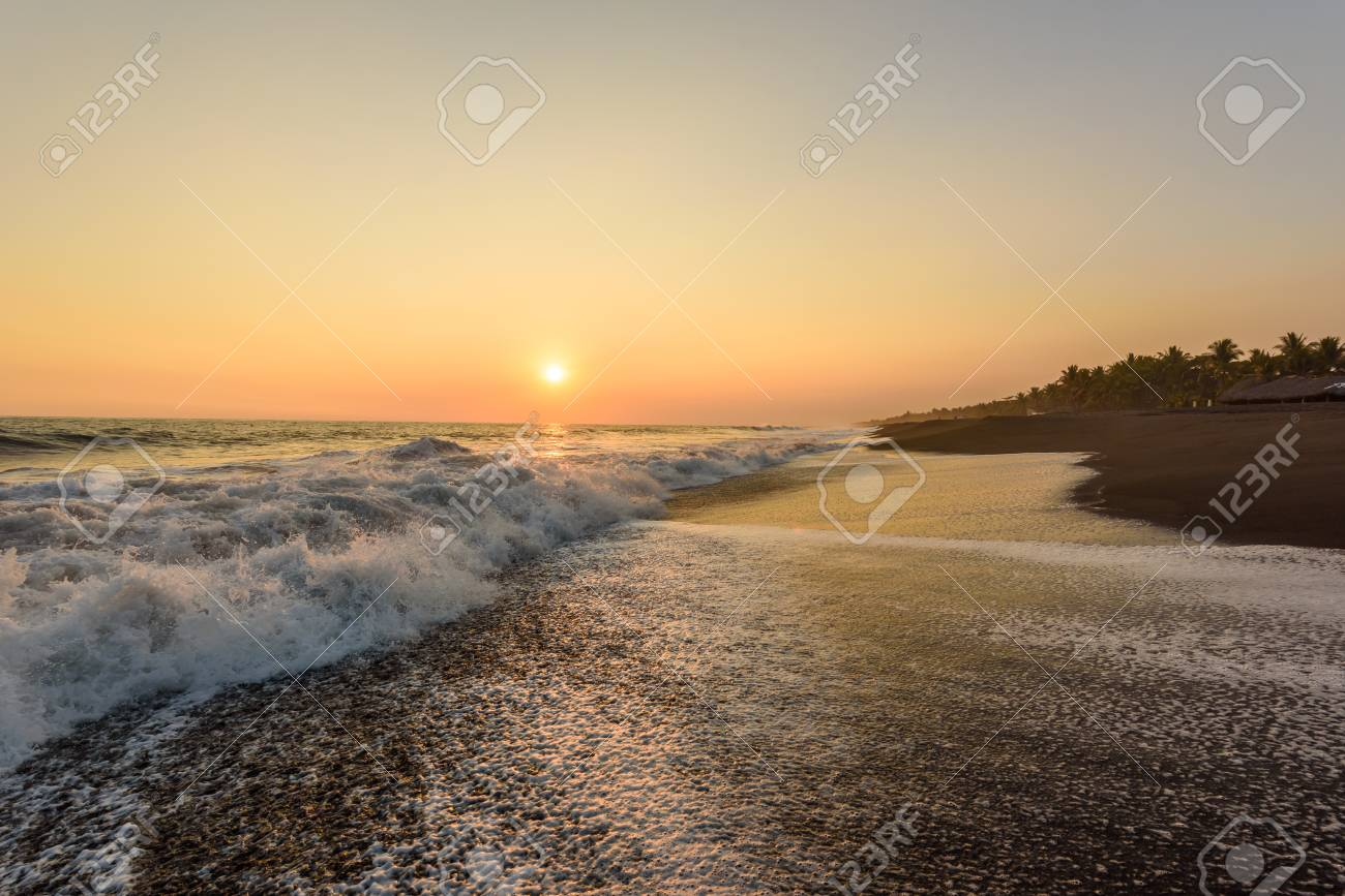 Sunset at Beach with Black Sand in Monterrico, Guatemala. Monterrico is situated on the Pacific coast in the department of Santa Rosa. Known for its volcanic black sand beaches and annual influx of sea turtles. Travel destination of Guatemala. - 91170148