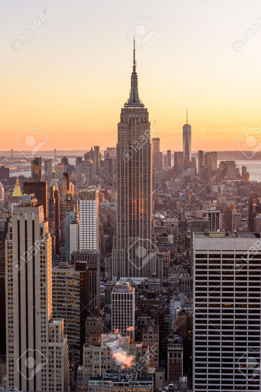 New York City - USA. View to Lower Manhattan downtown skyline with famous Empire State Building and skyscrapers at sunset. - 97597898