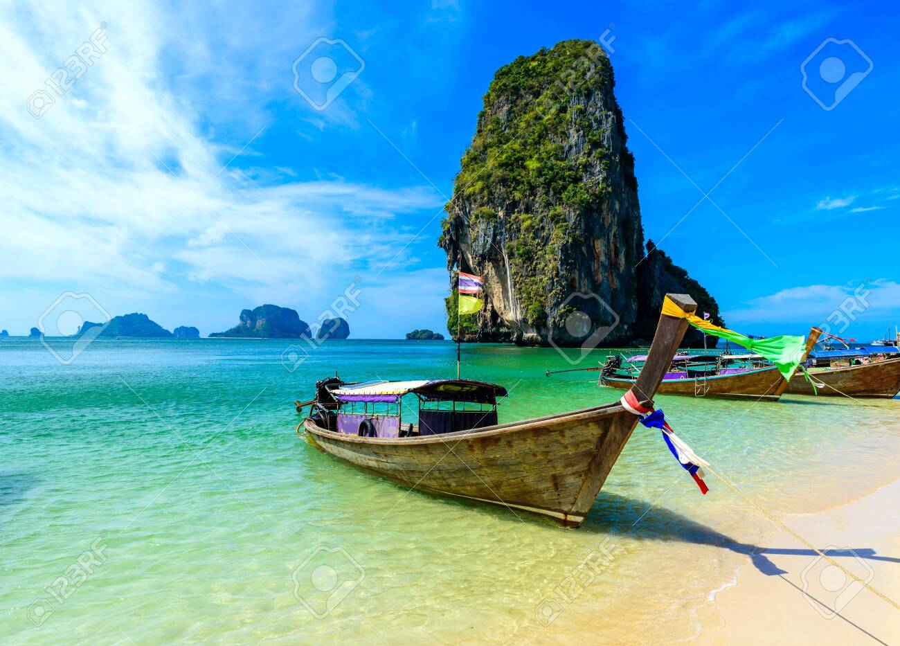 Ao Phra Nang Beach - Thai traditional wooden longtail boat on Railay Peninsula in front of Limestone karst rocks, close to Ao Nang, Krabi province, Andaman Sea, Thailand - 130811595